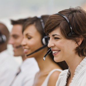 Happy call center employees with headset