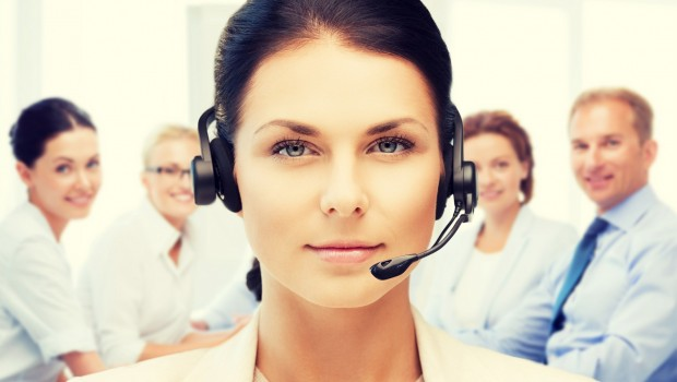 business and technology concept - helpline operator with headpho