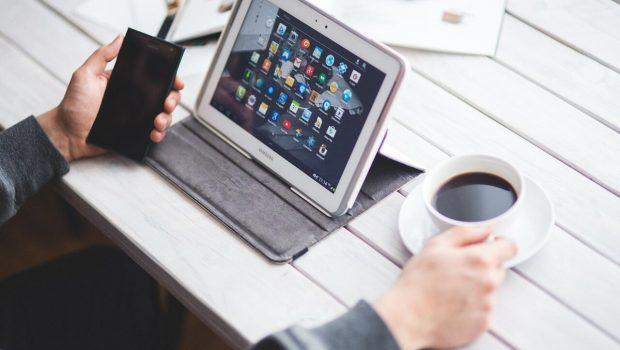 man using tab and smartphone
