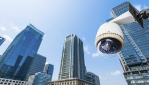 CCTV Camera or surveillance oeprating with building in backgroun