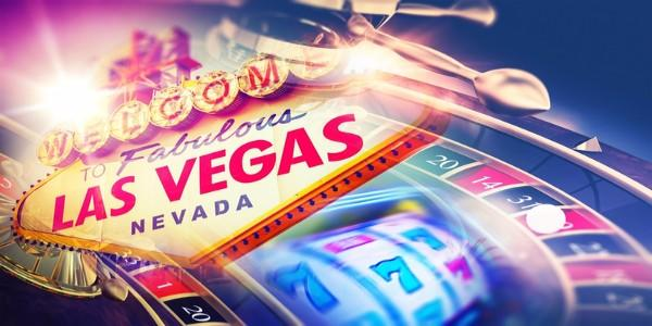 Slot machine and poker wheel with welcome to las vegas sign