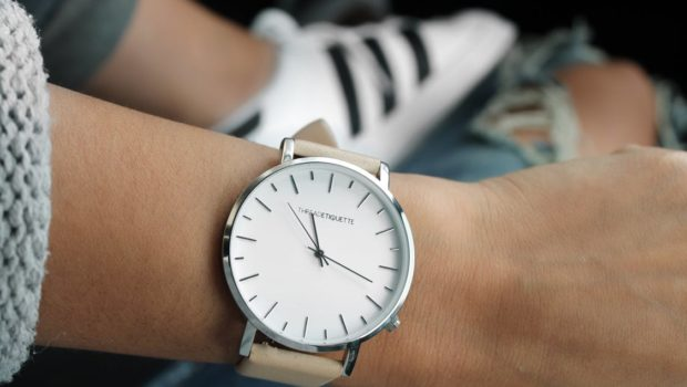 Beige Strap Silver Round Analog Watch Behind Adidas White and Black Superstar