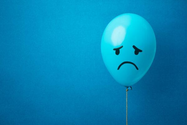 A blue monday balloon on a blue background Premium Photo