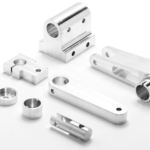 What is the main difference between CNC milling and CNC turning?